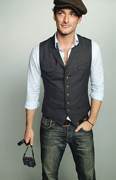 Vest and hat, tight shirt ... good style sense