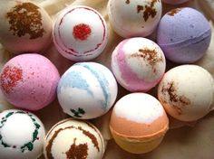 DIY Bath Bombs:  8 oz. of baking soda  4 oz. of citric acid  4 oz. of corn starch  4 oz. of Epsom salts (make sure these are fine grained)   ¾ tsp. of water  2 tsp. essential oil  2.5 tsp. almond oil (optional)  A few drops of food coloring  Round, plastic, snap together dome molds  Whisk  Bowl and cup for mixing  Fluffy towel