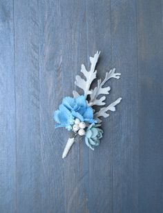 Winter wedding boutonniere for groom Blue flower by MetallyFlower