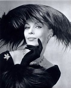 Feather hat by Albouy (Millinery), Paris 1956  Photo by Philippe Pottier  ~