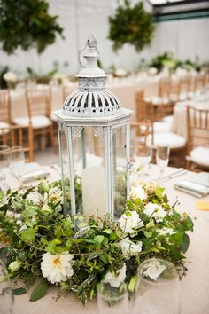 Beautiful garden-inspired lantern centerpiece. Flowers by Beautiful Blooms Photo by Lorraine Daley