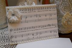 Music Lover Handmade Greeting Card for all occassions, white heavy card stock, cream, white, ivory, sheet music, pearls, blank inside with matching envelope. Will be send in protective Cellophane sheet. Give for birthdays, special holidays, friendship, teacher's gifts, great for giving out at home shopping parties, bridal shower gifts for door prizes, additional gift basket …