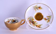 Royal Worcester miniature teacup and saucer painted