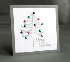 Silver embossed tree with brad ornaments