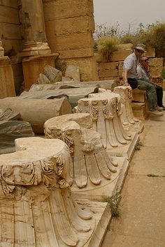 Roger & Pete sitting on column capitals, the Basilica, Leptis Magna, Libya, Northern Africa