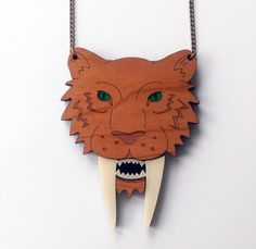 Make a (saber-toothed) statement with this acrylic and cherry wood necklace from Etsy seller @designosauryeah. #etsyjewelry