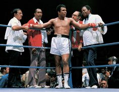Ali stands with trainer Angelo Dundee, assistant trainer Wali Muhammad, physician Dr. Ferdie Pacheco and assistant trainer Drew Bundini Brown before his bout with Ron Lyle in May 1975. Ali won the fight by technical knockout in the 11th round. Cassius Marcellus Clay, Jr. Muhammad Ali. [January 17, 1942 – June 3, 2016] ❥ A true Champ & A true Legend ! RIP* The Real Greatest Man. #Quotes #Ali #Boxe #Sports