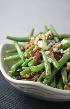 1 lb green beans     3 slices bacon     4 oz feta cheese     1 c pecans roasted or candied-chopped     1/2 t pepper     1/2 t kosher salt  /Cook green beans 2-3 minutes-place in bowl of ice water 2-3 minutes-set aside.  Cook bacon-add to beans to bacon drippings-cook for 2-3 minutes. crumble bacon-add to beans with feta cheese, pecans, salt and pepper.