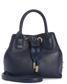 """Surf Rider Leather Crossbody in Regal - Cute, convenient, and compact, this satchel style crossbody holds everything you need while maintaining your chic aesthetic. Not too small and not too big, it allows you to carry your things without weighing you down. Perfect for a night out or a day of fun.  Mini satchel crossbody bag with removable shoulder strap and 14K polished gold hardware. Body: 100% Nappa leather 100% poly jacquard lining 3.5"""" handle drop 24"""" shoulder drop 9.3"""" L x 4.6"""" W x…"""