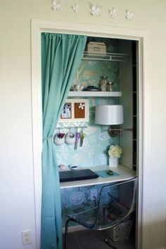 Remove the door from an existing small closet and hang a colorful fabric curtain instead. Add a floating desktop and open shelving to reinvent the office concept. For a fun surprise, install complementary printed wallpaper within the closet. Pull up a chair and you're ready to work.