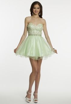 A short frilly beaded dress is the perfect prom 2014 choice! Girly elements mixed with high-fashion fabrics makes for one formal look that will not be forgotten. Steal the spotlight with an ornate all lace bodice with sweetheart neckline finished with a dazzling corset tie waist. This gorgeous bodice is adjoined with a full tulle party skirt ready for your glamorous arrival to prom! Short prom dresses are so in this season so, don't let this amazing style get away. Here's how to style the…