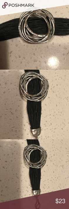 Bracelet Silver metal and black leather strap and silver metal clasps Cool looking and new! Jewelry Bracelets
