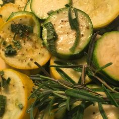 Roasted zucchini, yellow squash and garlic cloves with fresh parsley and rosemary.