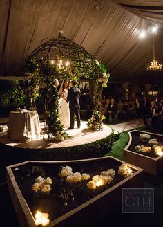 "The couple said ""I do"" in a tent outside that resembled a formal garden -- complete with pools of floating peonies."