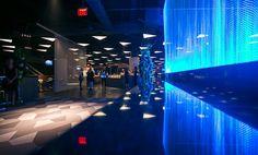 Dramatically lit Cascade Coil creates a focal point within Barclays Center interior lobby