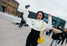 Tiffany Hsu in a J.W.Anderson top with a Loewe bag