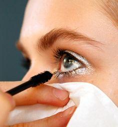 Best-Kept Beauty Secrets From Fashion Week press a tissue under eyes to catch stuff