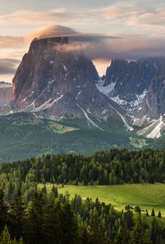 Dolomites, Italy (I love the clouds on top of the mountain)