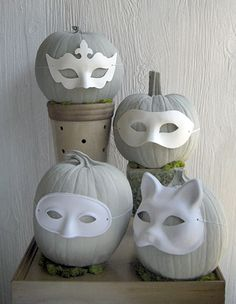 grey painted pumpkins with white painted masks. I think I'd leave them orange and use black masks though.
