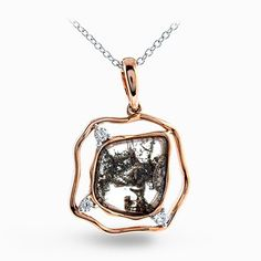 This dramatic yellow gold modern pendant is set with a 1.28 rose cut center brown diamond accented by glimmering .08 ctw glimmering round cut white diamonds. Print Page