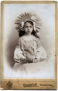 1880s. First Communion, vintage photo of girl in elaborate hat.