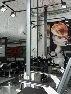 Prague-based Studio Muon completed a hair salon in Brno, Czech Republic, that looks like a cross between a warehouse and a dungeon