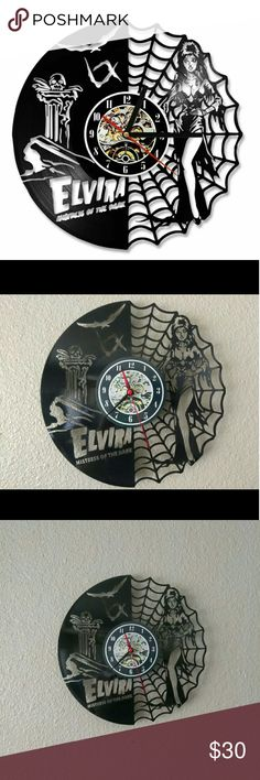 "Elvira mistress of the dark wall clock Approximately 12"" in diameter Brand new, works great Brand new battery included (1 AA battery) Laser cut into vinyl lp record  Tags: elvira mistress gothic punk rock psychobilly rockabilly grunge pinup horror goth clock wall decor decoration decorations hanging Other"