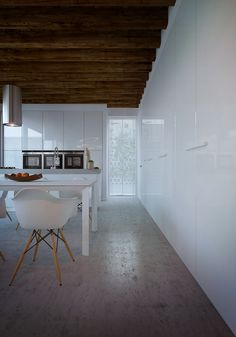 AG - example of incorporating wood elements into the kitchen with concrete floors and high gloss white cabinets.