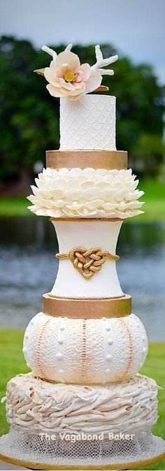 Unique ivory gold Wedding Cake - lotus knot carved tiers
