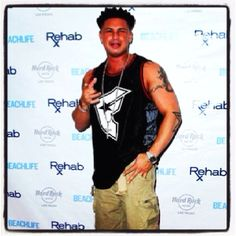 DJ Pauly D wearing his LBJC Khaki Cargo Shorts to the Rehab Opening in Vegas