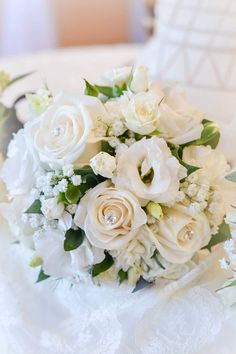White roses,lisianthus and babies breath.