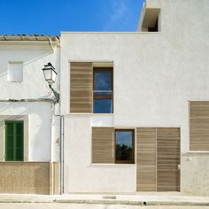 Spanish studio Ripolltizon added this family home onto the end of a row of traditional houses in Mallorca, Spain #Architecture