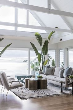 A home need not be rife with anchors, shells, and maritime flags to have a soothing, coastal feel. Let me introduce you to my ideal modern beach house. Drawing a palette from sand, sky and sea…More Coastal Living Rooms, Coastal Homes, My Living Room, Living Room Decor, Beach Living Room, Living Area, Cottage Living, Tropical Living Rooms, Plants In Living Room