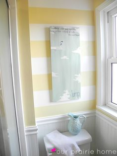 Our Prairie Home: Downstairs Bathroom {A Reveal} Striped Accent Wall Yellow and White Guest Bathroom