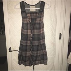 Free people button up tunic Free people button up plaid tunic.  It has a cute lace up detail in the back and a knit contrast fabric at the yoke. Free People Tops Button Down Shirts
