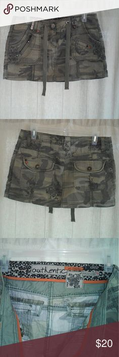"Cute camouflage mini skirt with bling and details This is a really cute mini skirt in camouflage by krisp. Tags inside say ""authentic"", ""love your combats"", and ""ref: V:0009865"". This is a size 12 and in very good condition. If you are interested please check measurements with me before you purchase. Thanks for looking! Krisp Skirts Mini"