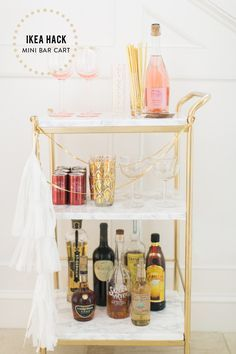Photography: Ruth Eileen Photography - rutheileenphotography.com Read More on SMP: http://www.stylemepretty.com/living/2015/12/29/ikea-hack-diy-mini-bar-cart/