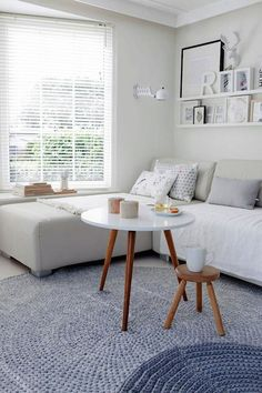 Ideas And Inspiration For Organizing Small Living Rooms. Love the mini-tables- they would be great for entertaining and easy to store.