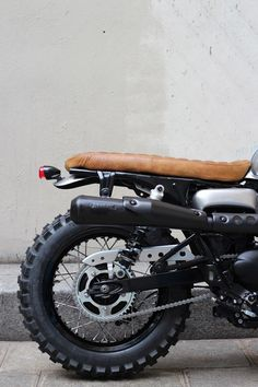 Two wheels good, four wheels bad / Possible rear end design minus the scrambler exhaust
