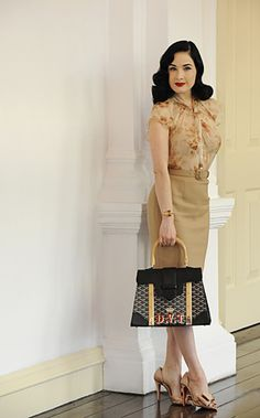 Dita Von Teese in Singapore, dressed in Christian Dior, Christian Louboutin heels and Goyard Miss Saigon bag.