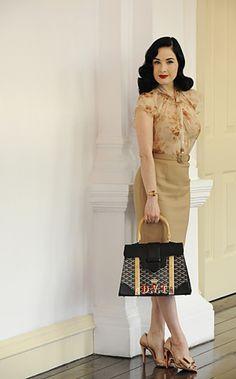 Dita Von Teese in Singapore, dressed in Christian Dior, Christian Louboutin heels and Goyard Miss Saigon bag.