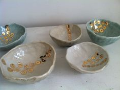 Antonia Campanella.  Porcelain bowls with shino or celedon glaze with gold luster accents  http://acceramics.com/artwork/2379676_Fancy_Bowls.html