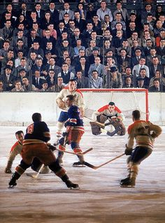 Montreal Canadiens goalie Jacques Plante surveys the ice without a mask during a game between the Canadiens and the New York Rangers at Madison Square Garden. Plante was the first NHL goalie to wear a goaltender mask on an everyday basis, a practice he started during the 1959-60 season.