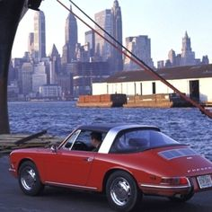 """""""""""Give me such shows - give me the streets of Manhattan!"""" Walt Whitman, American poet  1967, View of New York City and a Porsche 911 with, for the first…"""""""