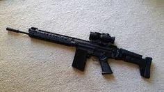 Modified SA 58 assault rifle http://riflescopescenter.com/category/bsa-riflescope-reviews/