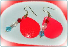 http://diginanchors.com/EarringsAlure_DanglePinkHorizon - The unique Stingray Series of EarringsAlure is made from quality lures with bright hot pink colors that are hotter than ever. Having the fleck finish allows it to sparkle when hit by light. Brilliant sparkling red bead and elegant crystal are added to enhance the beauty of the earrings and the wearer.The dangling earrings are 2 inches long and 3/4 inch wide.