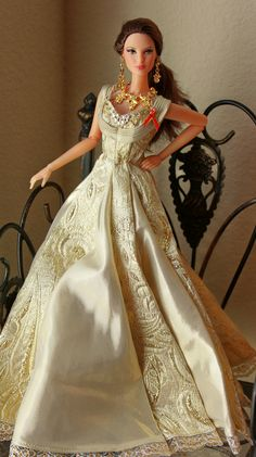 Avondale  is  modeling  a  gown  created  exclusively  for  TRU  to  commemorate  their  50th  anniversary.