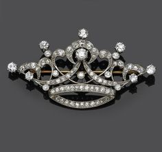An antique diamond crown brooch, circa 1910