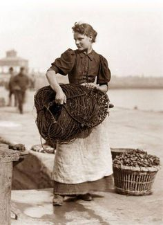 One of Frank Sutcliffe's photos.This one is 'Fetching the Lines' taken in Whitby,a fishing village in Yorkshire. 1880s