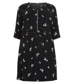 """Plus Size. Bring floral prints into this season's wardrobe with this black zip front number. Perfect with tights and ankle boots for chillier days.- All over floral print- Zip front- Rounded neckline- 1/2 sleeves- Tie waist- Casual fit that is true to size- Model is 5'9""""/180cmCreated for women of size 18 to 28/EU 46 to 56**Selected styles are available up to size 32/ EU 60"""